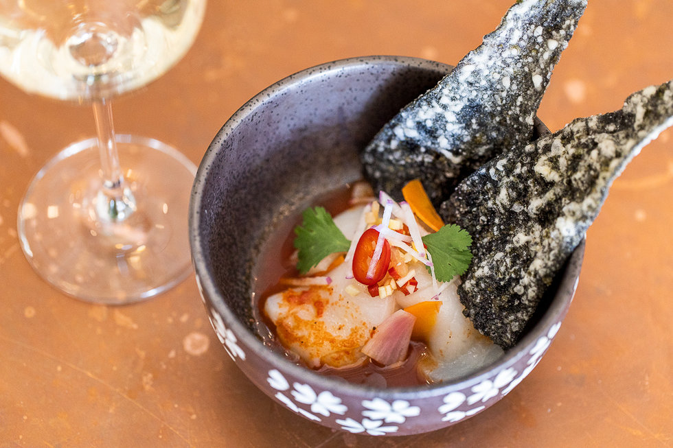 The scallop ceviche is a well-balanced, light bite with a few slices of spicy chile, pickled shallots for a hint of acid, and crunchy nori chips.