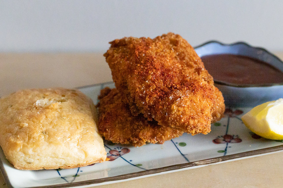 We didn't see this coming: fried chicken, topped with creole spices and paired with a thick buttery biscuit, is available in two pieces or four.