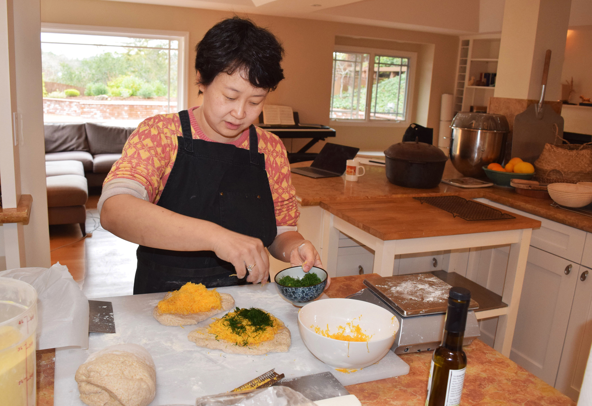 Bakery founder Tian Mayimin makes a wide variety of naturally leavened breads in her kitchen in Menlo Park, such as yummy, cheese-filled rolls.