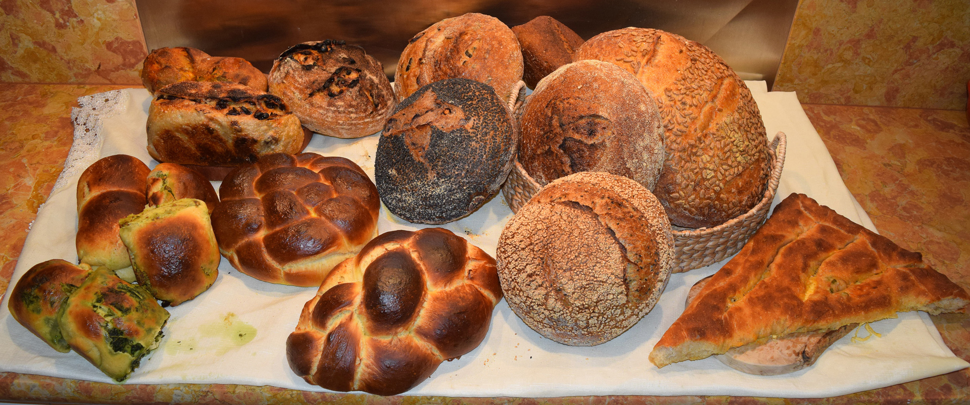 Country breads, challah, filled rolls, fougasse and other kinds of breads are made by hand in Little Sky Bakery's kitchen workshop.