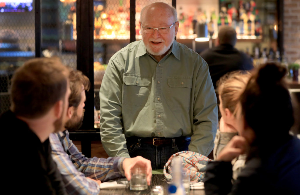 Sweet T's owner Dennis Tussey talks with customers, Monday, March 4, 2019 during a soft opening of the restaurant's new location in Windsor.