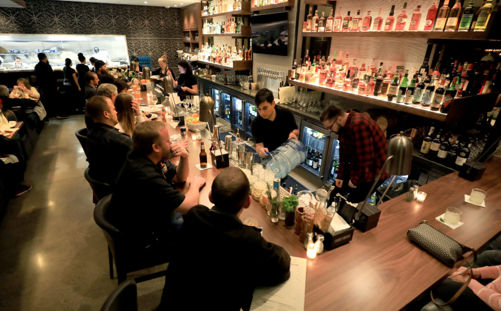 The bar is packed during a soft opening for Sweet T's in Windsor, Monday, March 4, 2019.