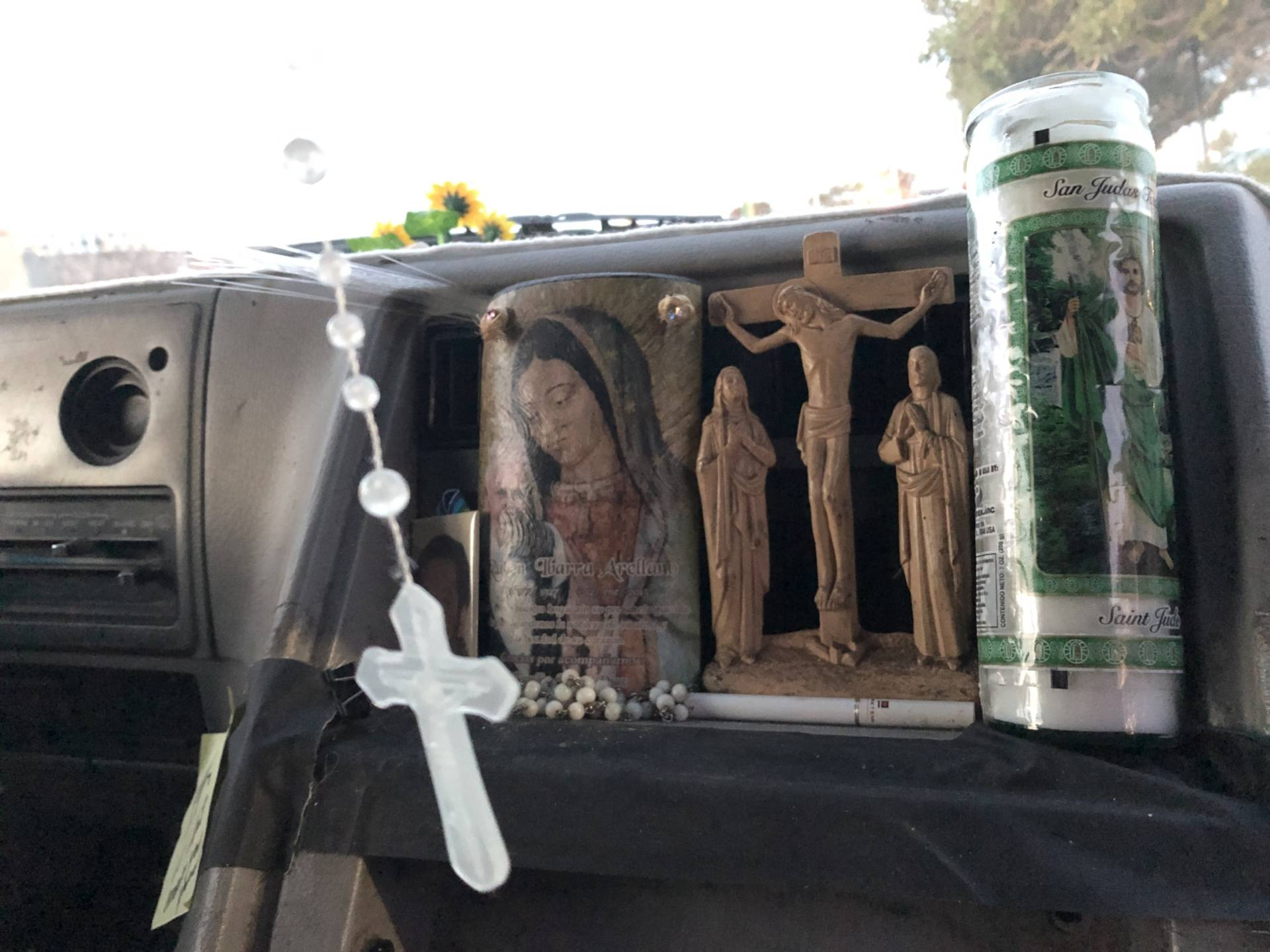 Armando Ibarra, a hotel restaurant worker in San Francisco, lives out of his van to save money — and to avoid an hours-long commute from San Jose. A holy candle rests on his dashboard; a rosary hangs from the rearview mirror.
