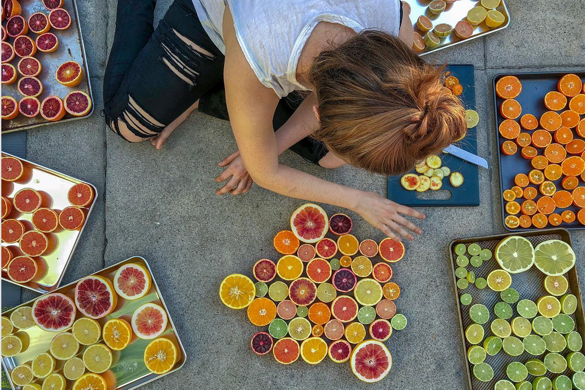 Aliza Sokolow arranges some citrus.