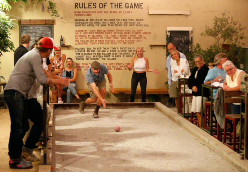Dave White throws his bocce ball with style during bocce league play at Campo Fina restaurant in Healdsburg, California