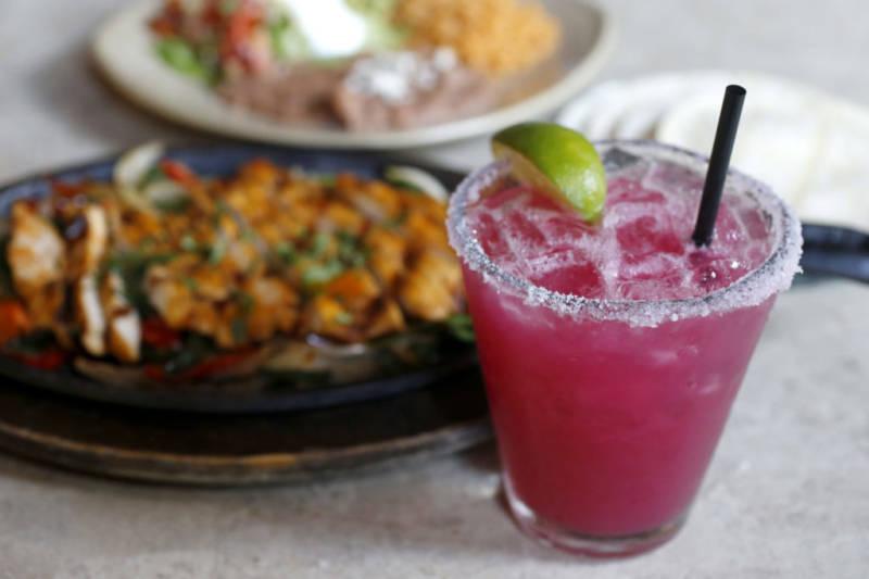 A Prickly Pear Margarita with chicken fajitas at La Rosa Tequileria & Grille in Santa Rosa