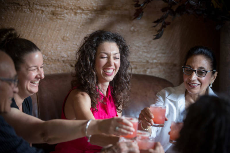 Danielle Alvarez, center, toasts to friends and family during a special dinner menu at Mateo's Cocina Latina in Healdsburg, Calif. Saturday, June 25, 2016. Mateo's Cocina Latina is beginning to offer sustainable feasts that include every part of the animals butchered for the dinner, including suckling pig brain mousse and pigs tails