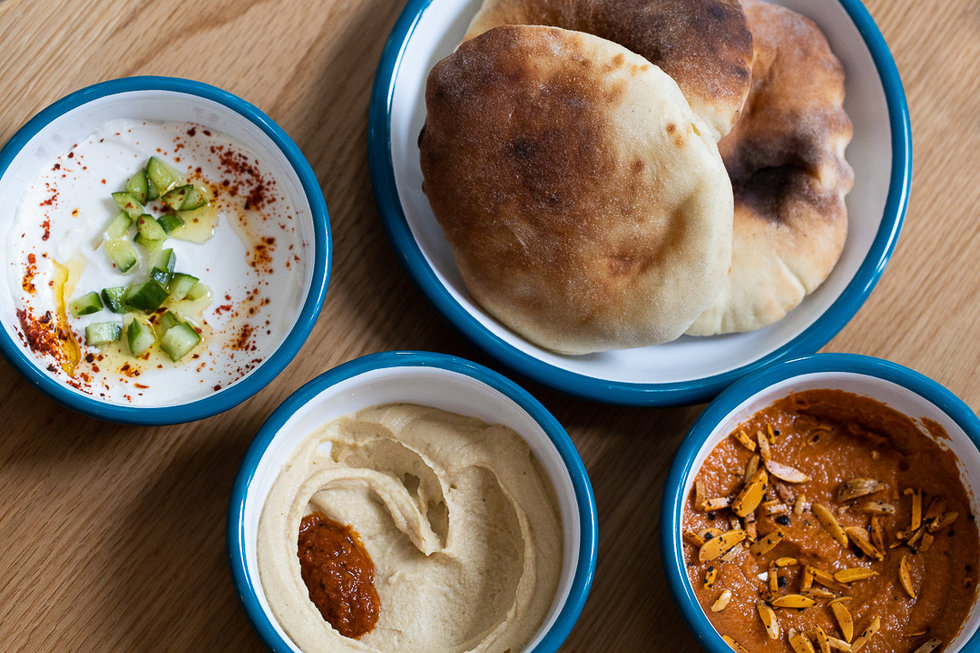 From left: yogurt dip, hummus, and muhammara.