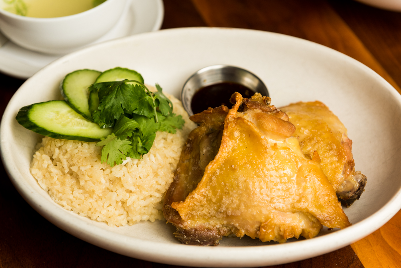 Her signature Singapore Chicken Rice comes with poached and flash fried chicken thighs.