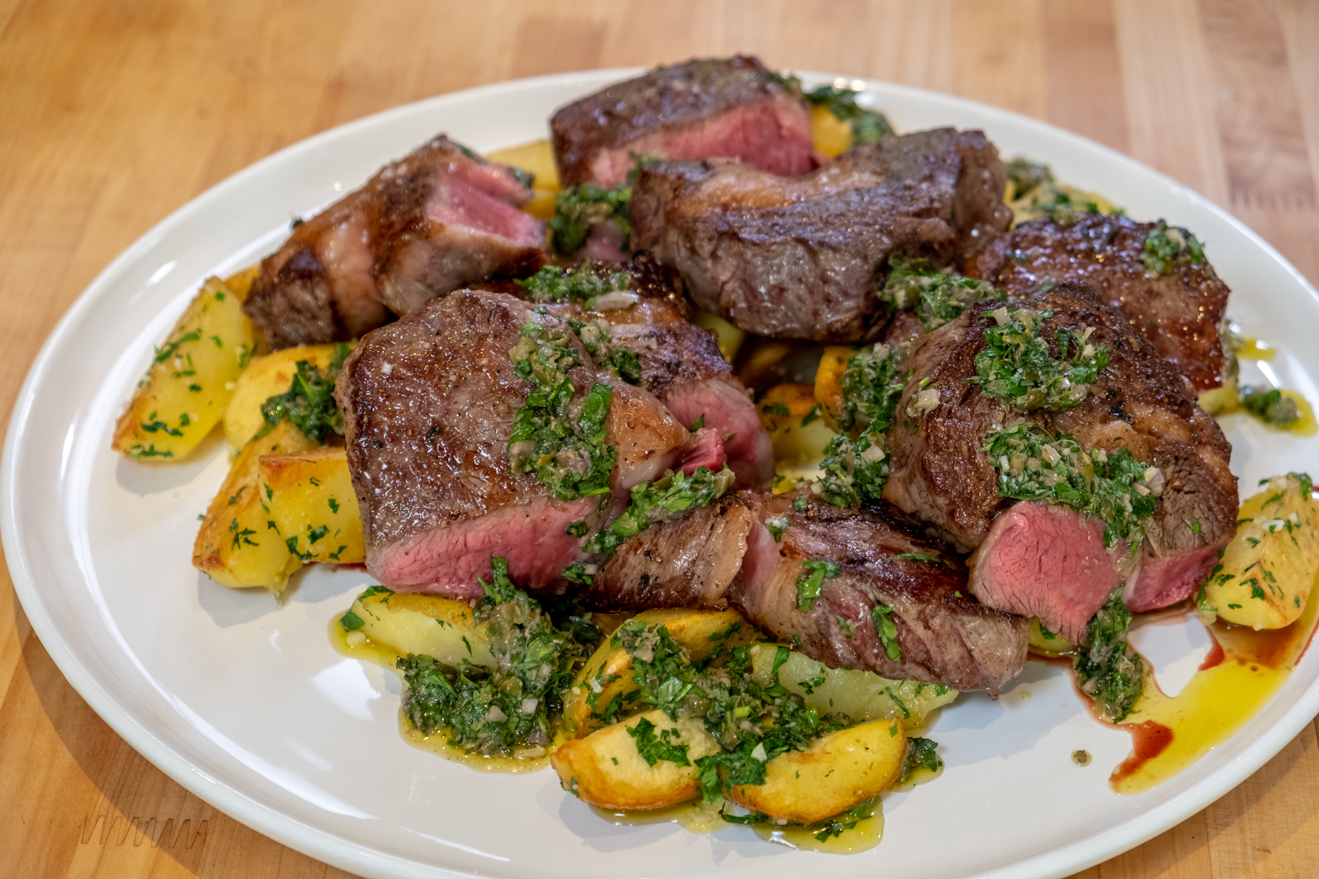 Traci Des Jardins's grilled ribeye with duck fat potatoes and salsa verde.