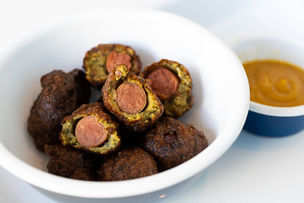 These corn dog bites have been given the Aaron London treatment: an upgrade from traditional corn dog breading to a variation made with tasty falafel.