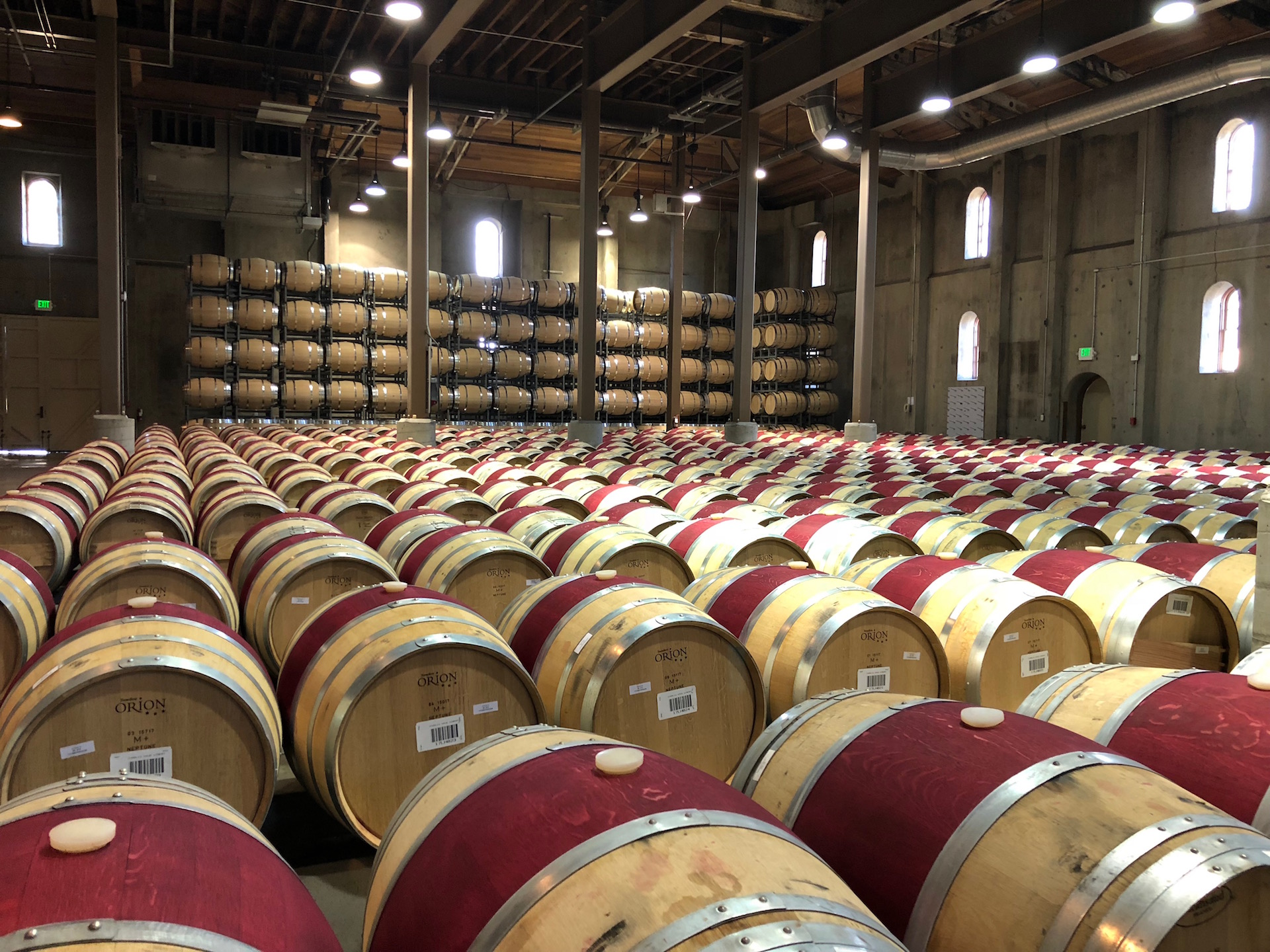 The signature burgundy painted barrels resting at Charles Krug Winery