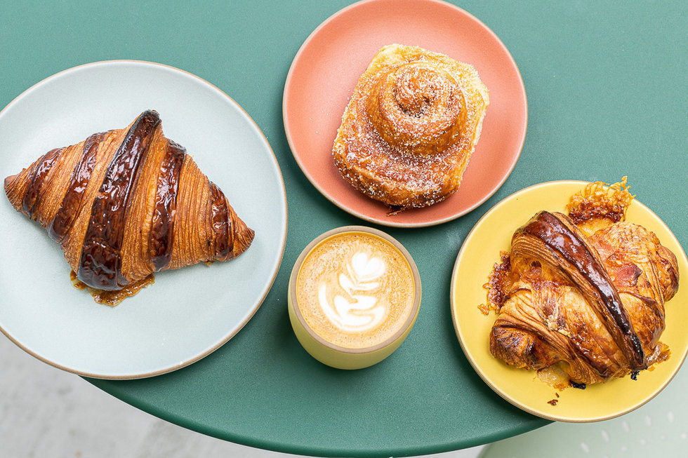 A buttery croissant, the legendary morning bun, and a ham-and-cheese croissant at Tartine in the Inner Sunset.