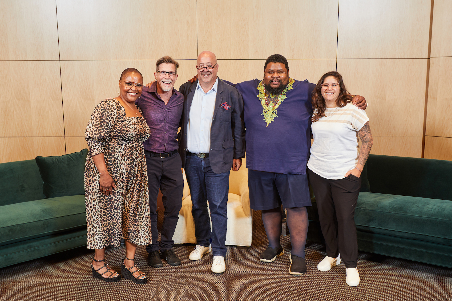 """""""Conversations at Copia"""" panelists (left to right) Tanya Holland, Rick Bayless, Michael Twitty, and Emiliana Puyana with host Andrew Zimmern (center)."""