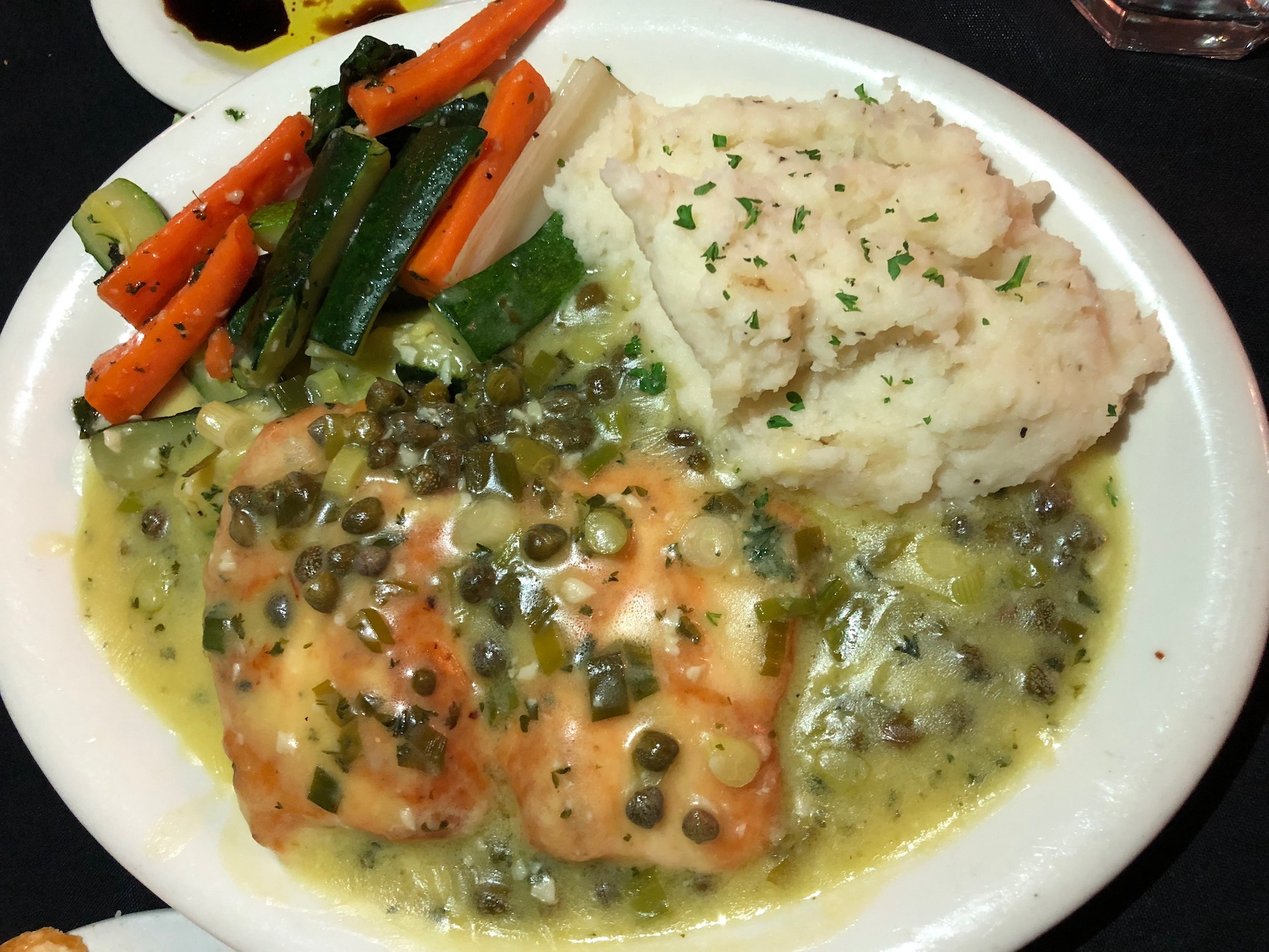 Celebrity Dining: Tried-and-true classic Italian standards like salmon picatta are nicely prepared by the Bertolucci's kitchen.