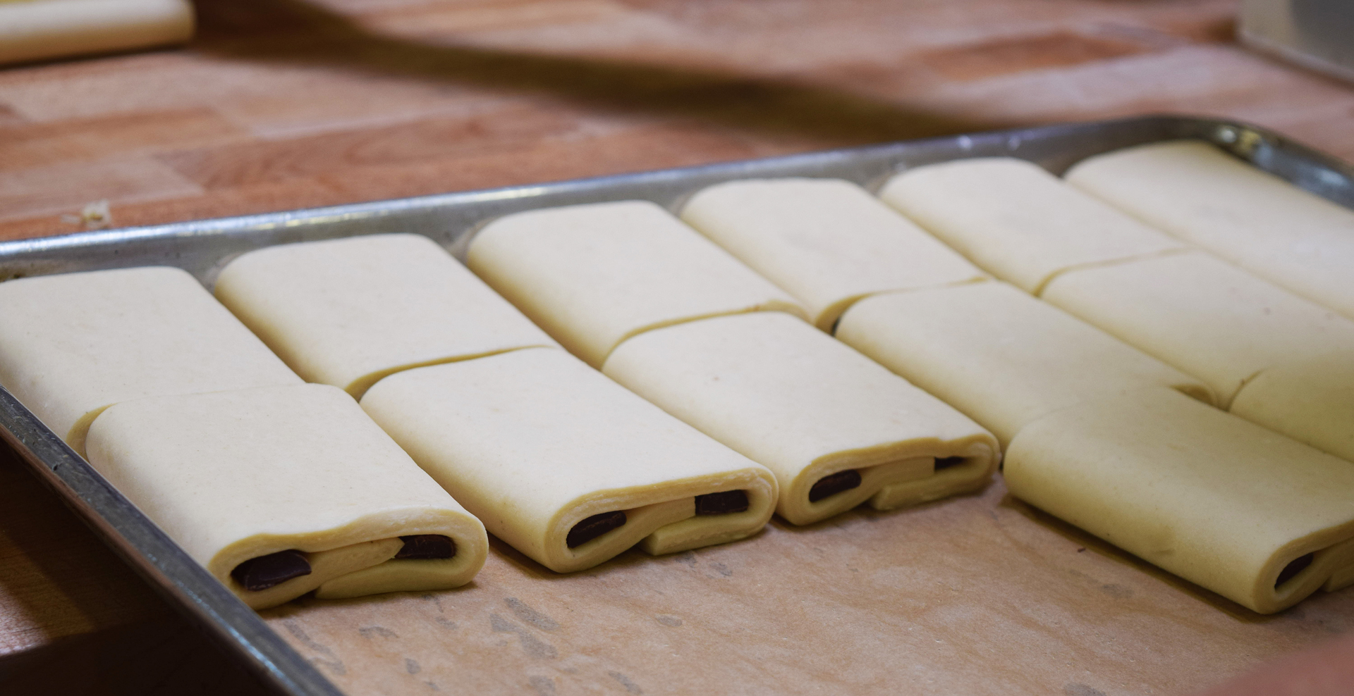 Croissants stuffed with chocolate await their time in the oven.