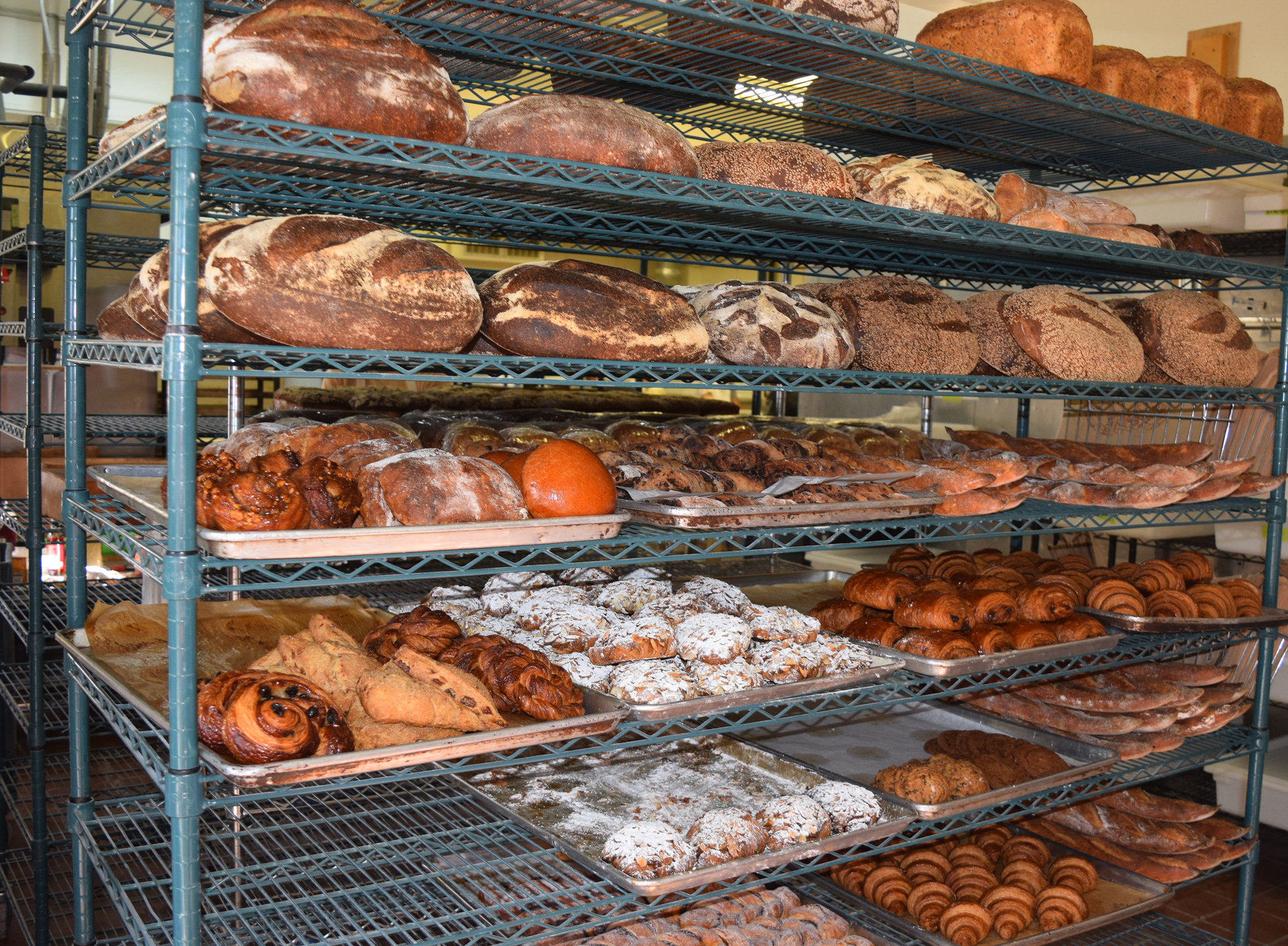 Shelves of breads and pastries inside the bakery door await morning customers.