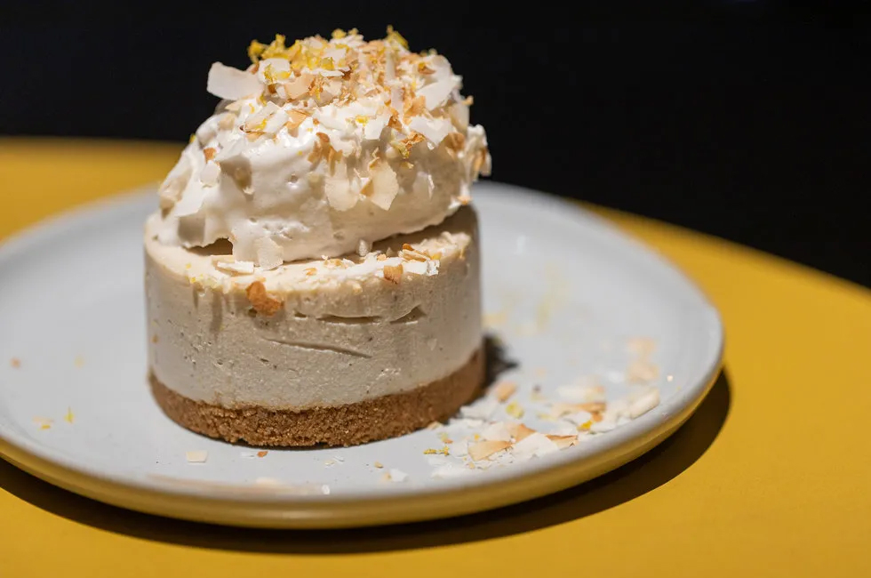 Meyer lemon agave cheesecake with a gluten-free graham cracker crust and whips of coconut.