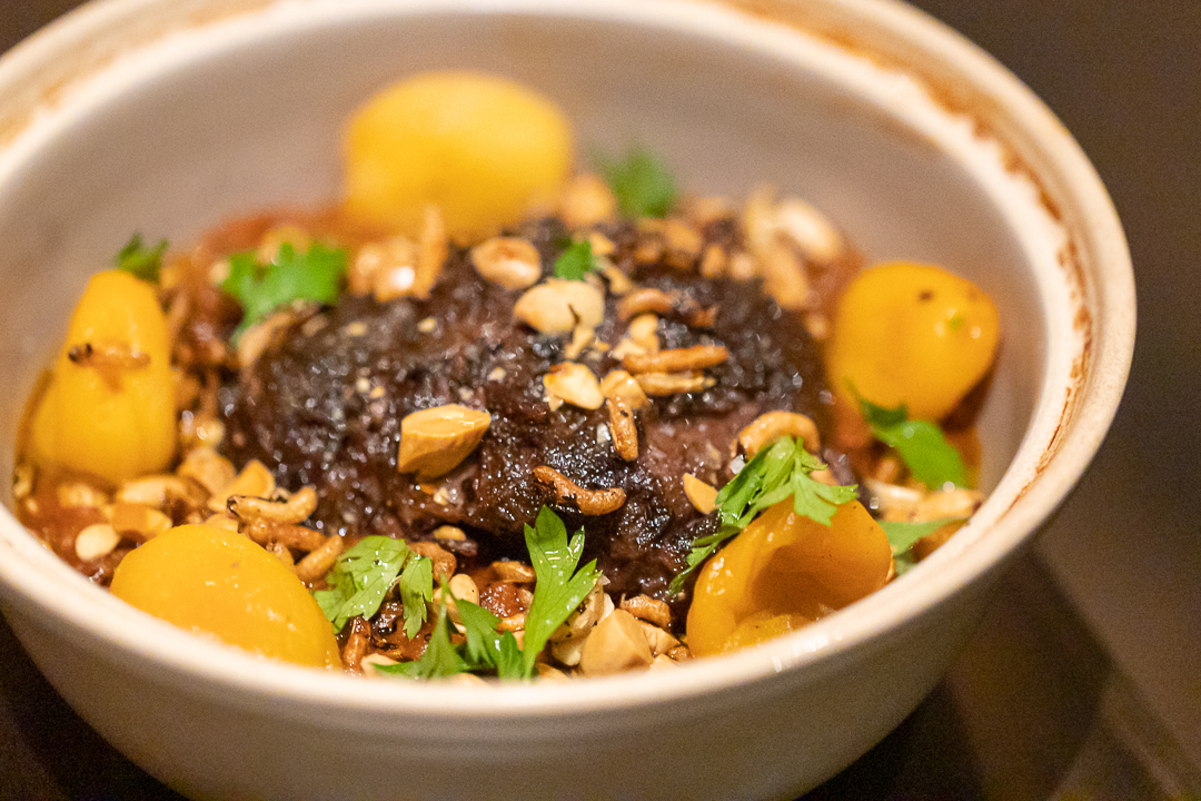 The beef cheek tagine will arrive in the traditional clay pot; when the lid comes off, breathe in the aroma of a steaming hearty stew with tender chunks of meat, rice puffs, almonds, apricots, and spiced root vegetable jam.