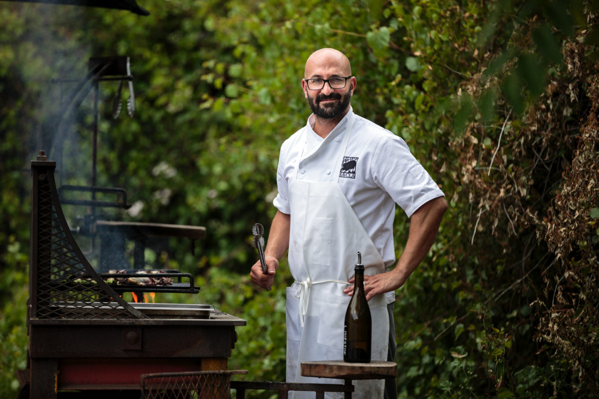 Dino Bugica, chef/owner of Diavola grilling vegetables