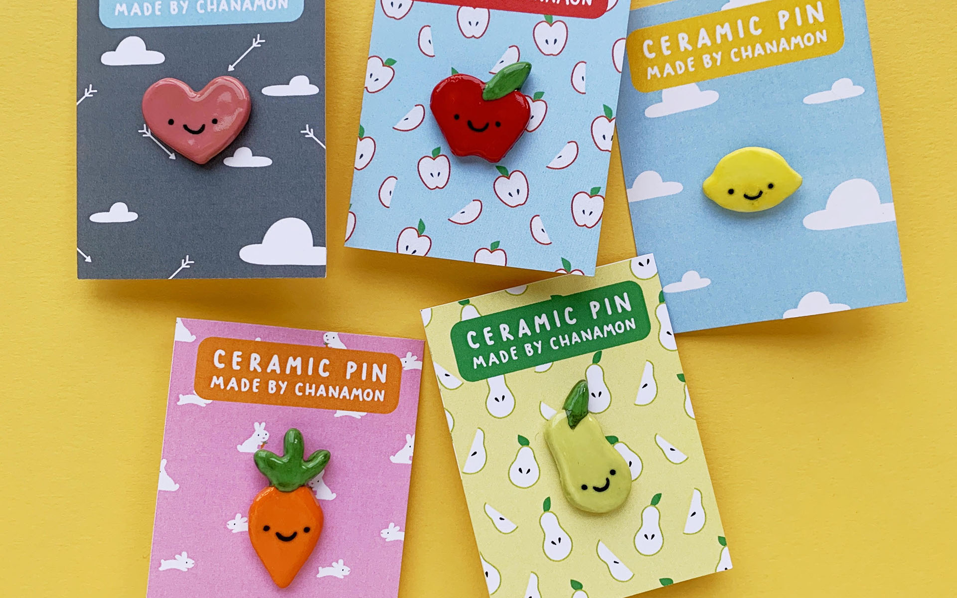 An assortment of enamel pins from Made by Chanamon