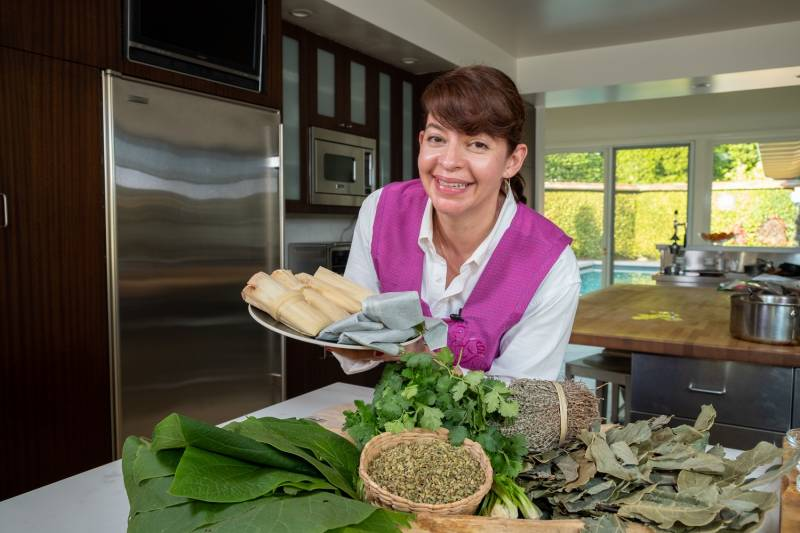 Chef Dominica Rice-Cisneros with a plate of finished tamales