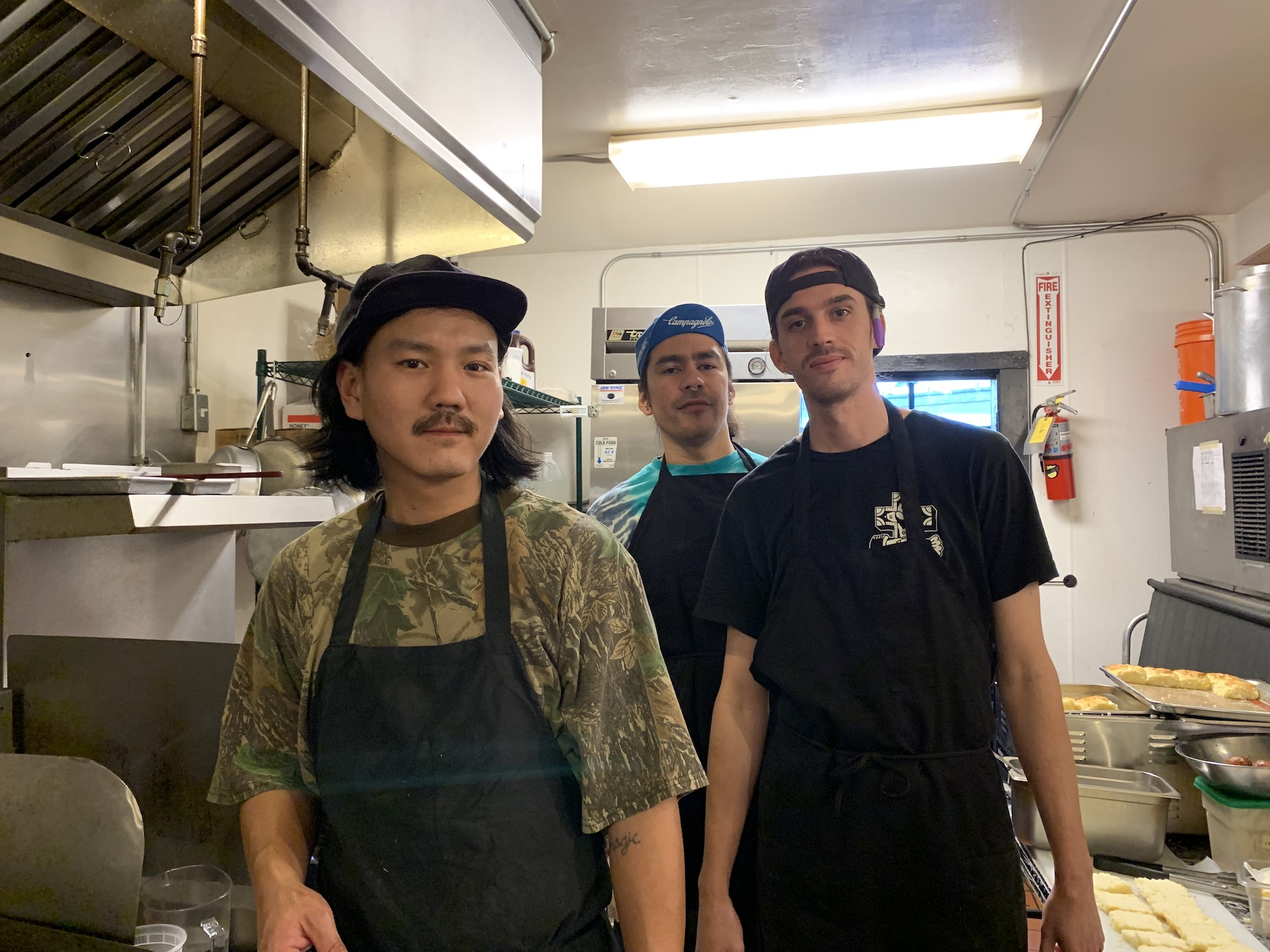Lovely's chef Mikey Yoon along with Javi Palacios and Cameron Kauzer working a pop-up at Eli's Mile High Club.