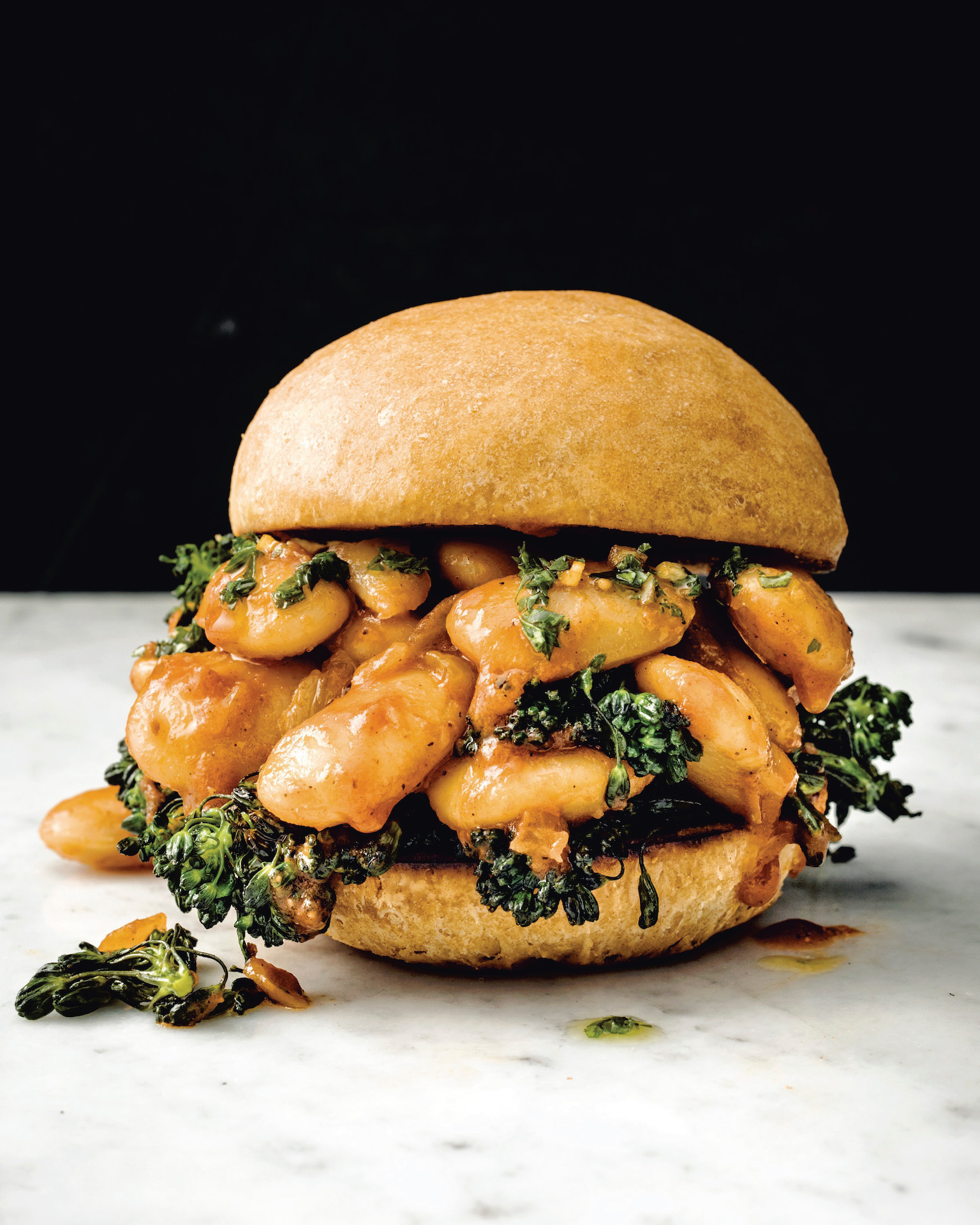Chef Bryant Terry's big beans, buns and broccoli rabe rabe packs protein and texture between a teff and flour bun.
