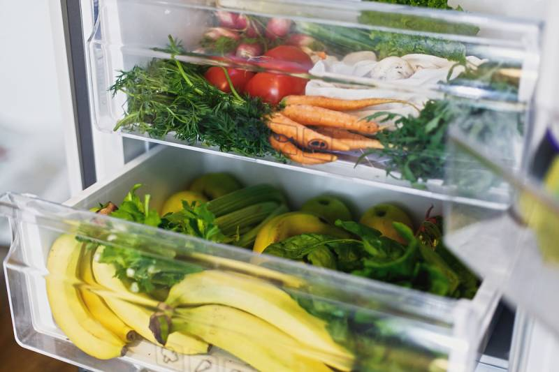 Open fridge filled with produce