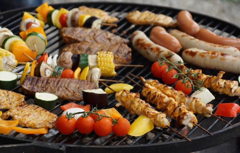 meat and veggies on a grill