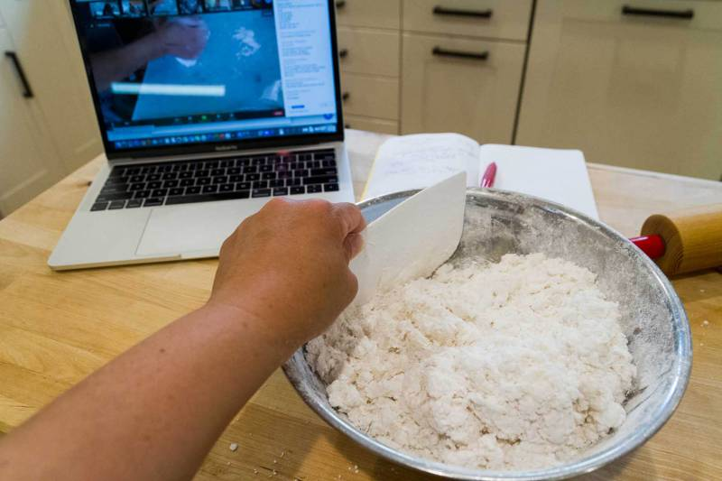 Rice and tapioca flours are mixed with boiling water to make khao piak sen noodles during an online cooking class with 18 Reasons