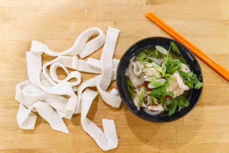 Khao piak sen Thai chicken soup with handmade rice and tapioca noodles