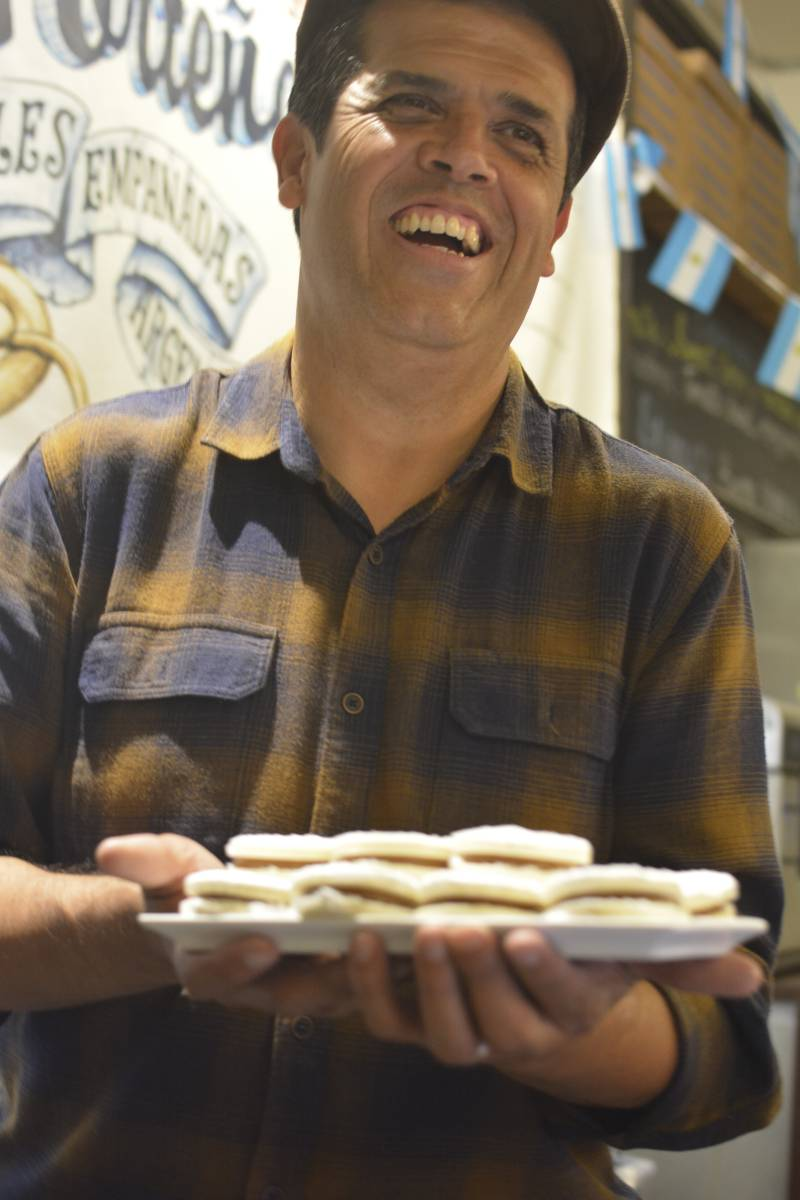 Chef Joseph Ahearne holding a tray of alfajores