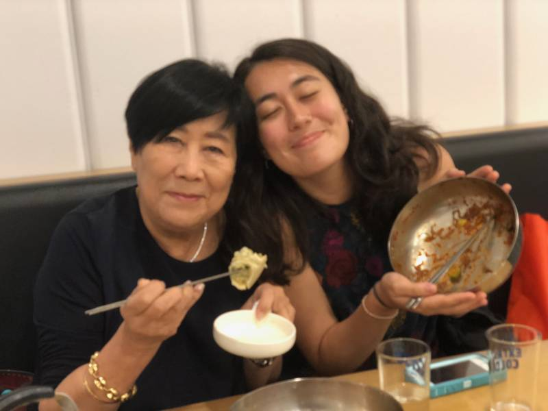 Granddaughter and grandmother eating
