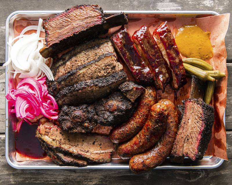 Selection of meats, hotlinks, brisket and ribs on a metal sheet tray