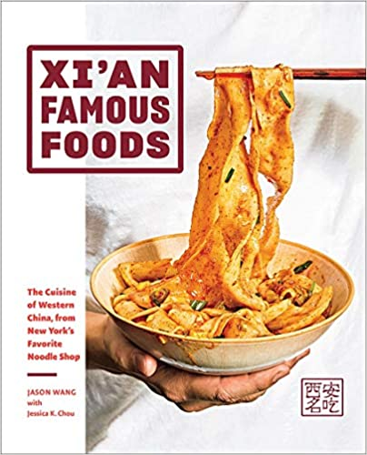 Xi'An Famous foods cookbook cover with someone pulling noodles from a bowl with chopsticks
