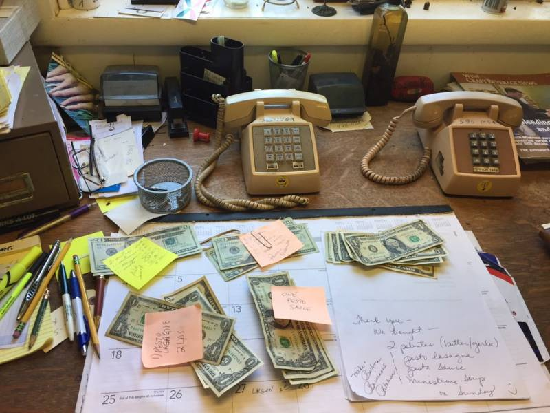 Piles of cash on the desk of the Pasta King at his Cotati kitchen.