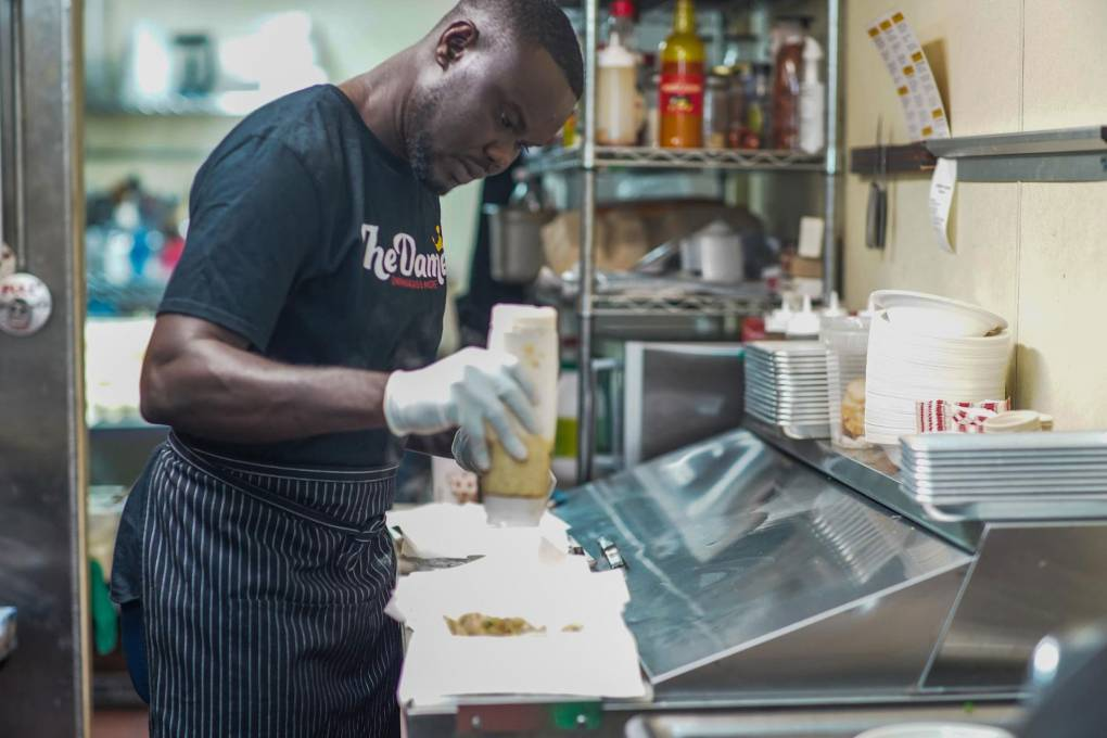 Oumar Diouf in the kitchen of his restaurant, The Damel, in downtown Oakland.