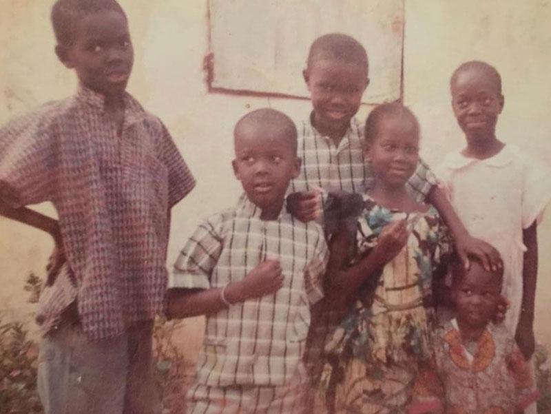 Oumar Diouf with siblings in Senegal.