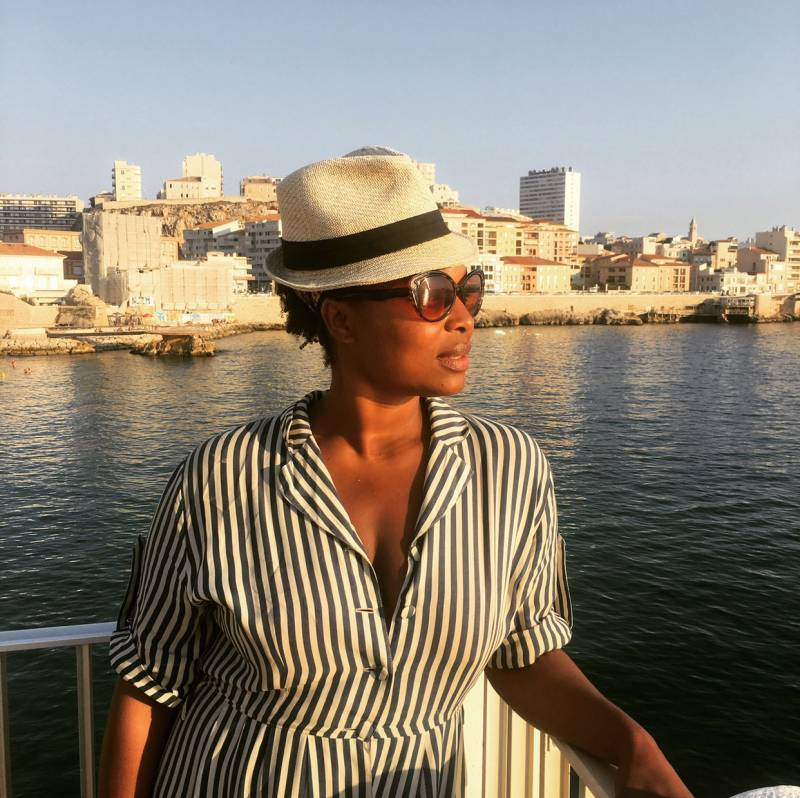 For the first time in years, Monifa Dayo won't spend this holiday season in Oakland, but rather, in Dakar.