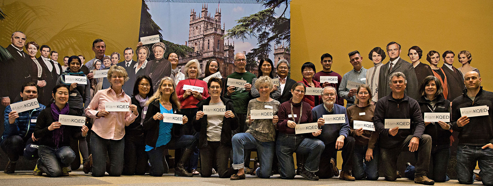 KQED Pledge Volunteers Standing in front of Downton Abbey backdrop