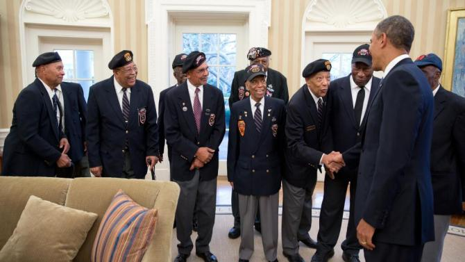 President Obama greets a group of black veterans at the White House.