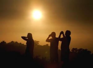 Tourists snap pictures of a murky sunset in San Diego.  (Sandy Huffaker / Getty Images)