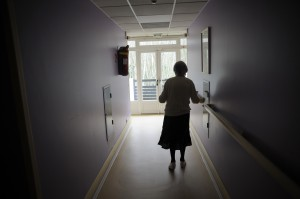 A woman, suffering from Alzheimer's Disease, in a retirement home corridor. (Sebastien Bozon/AFP/Getty Images)