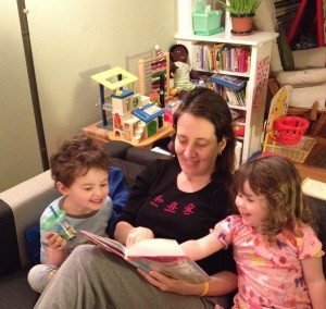 Karen Witham reads to her children, giving her husband a chance to recharge.
