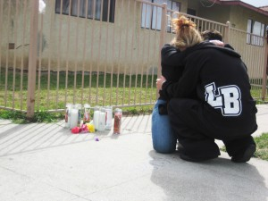 The mother and brother of murder victim Meldrick Melgoza embrace at the site where he was shot. (Photo: Anabell Romero)