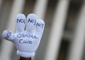 Protestor at Supreme Court in March during oral arguments on the Affordable Care Act. (Getty Images: Mark Wilson)