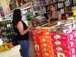 Rosa Lara talks with Alejandra Nava at La Raza market. Lara is a paid organizer for the community coalition against beverage taxes.