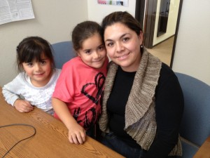 Maria Garibay worries her daughters won't be able to stay with their current doctors when they switch from Healthy Families to Medi-Cal next year.(Mina Kim: KQED)