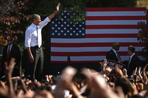 President Barack Obama waves to an audience of about 15,000 supporters during a campaign rally in Virginia (Photo by Chip Somodevilla/Getty Images).